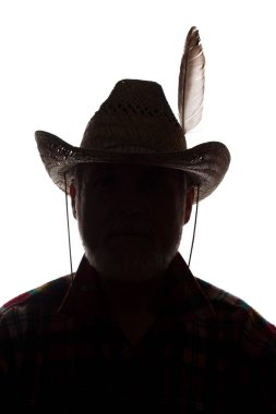 Old man in cowboy hat, front view - dark close-up silhouette