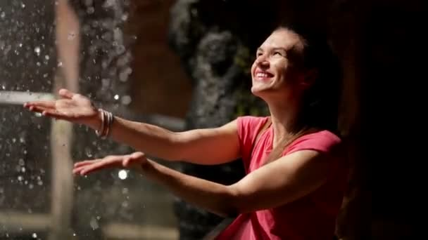 The Happy Woman Enjoys the Falling Water Drops. Water is the Source of Life.