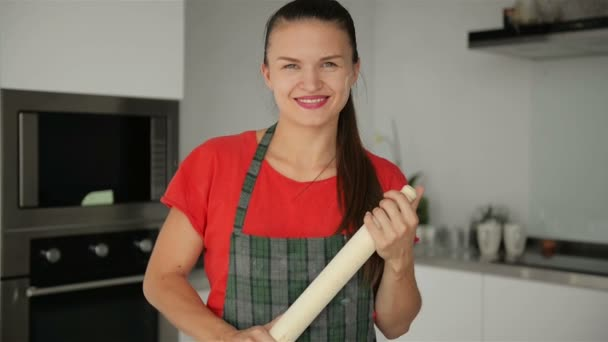Portrait of Young Smiling Girl On Kitchen Background. She Looks So Happy Holding Rolling Pin.
