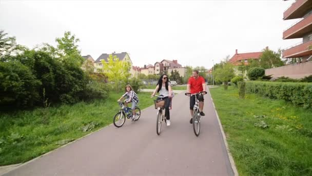 Parents With Their Kids Are Riding On Bikes. Happy Family Spending Time Together.