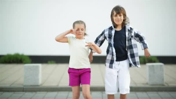 The Boy and the Girl Have Fun Together. They Have a Dancing Battle Standing on the Stones.