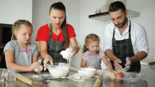 Family Has Fun With Each Other Playing With Flour  Happy Parents in Aprons  Help Kids Cooking