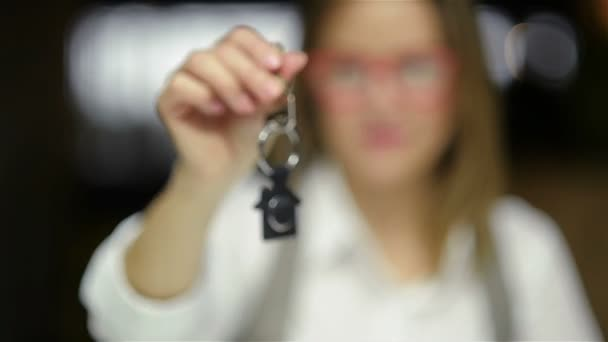Selective Focus Of Business Lady Holding New House Key And Smiling. Close Up Portrait Of Real Estate Agent.