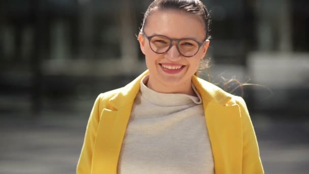 Portrait of a Cheerful Smiling Young Business Woman In a Yellow Coat. She Has Very Good Mood Spending Time In a City.