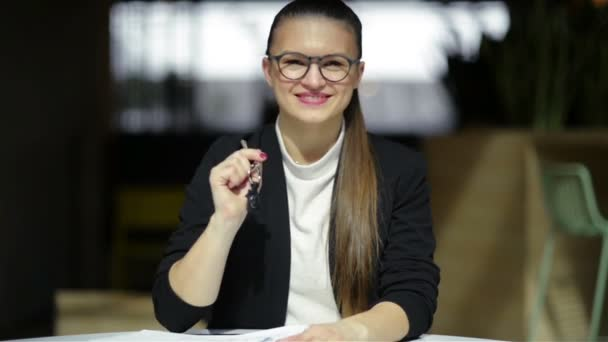Young Happy Smiling Business Woman Or Real Estate Agent Showing Keys From New House. Isolated Over Background. Focus On Keys.