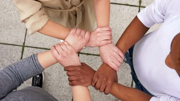 Symbolic plexus of hands with different skin colors.