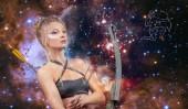 Fotografia Segno zodiacale Sagittario. Concetto di astrologia e Oroscopo, bella donna Sagittario sullo sfondo galassia
