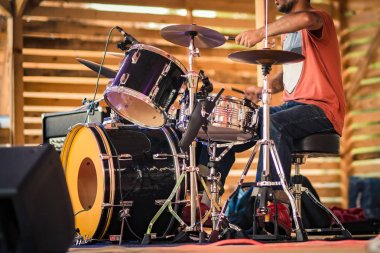 Drummer performing on stage.