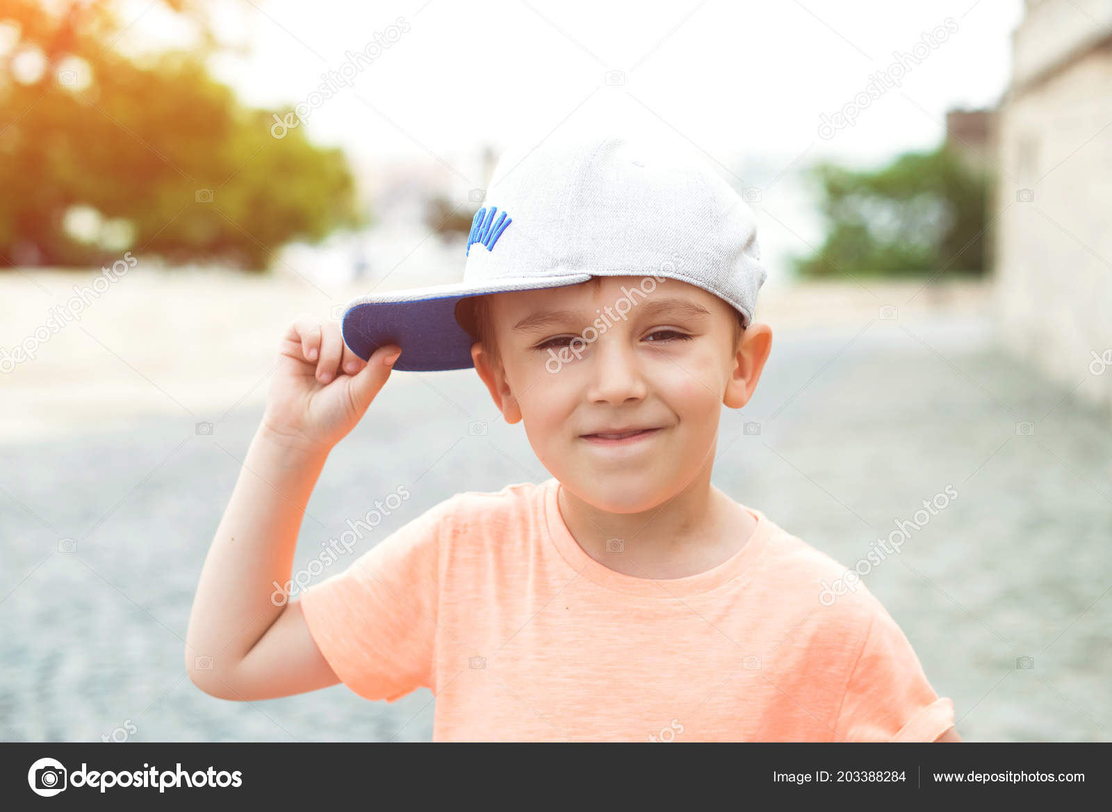 City style. Urban kids. Happy childhood. Kids fashion.The lovely little boy  in baseball cap. Summer holidays. Funky little boy in city street– stock  image 86d1a72abc48