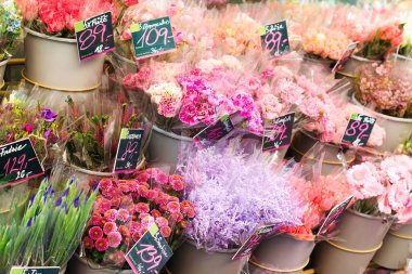 Flower shop with colourful bouquets. Flower stand outdoors. Street flowers market. Fresh colorful flowers. Flowers delivery, creating order.