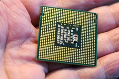 Hand holding a processor from a PC