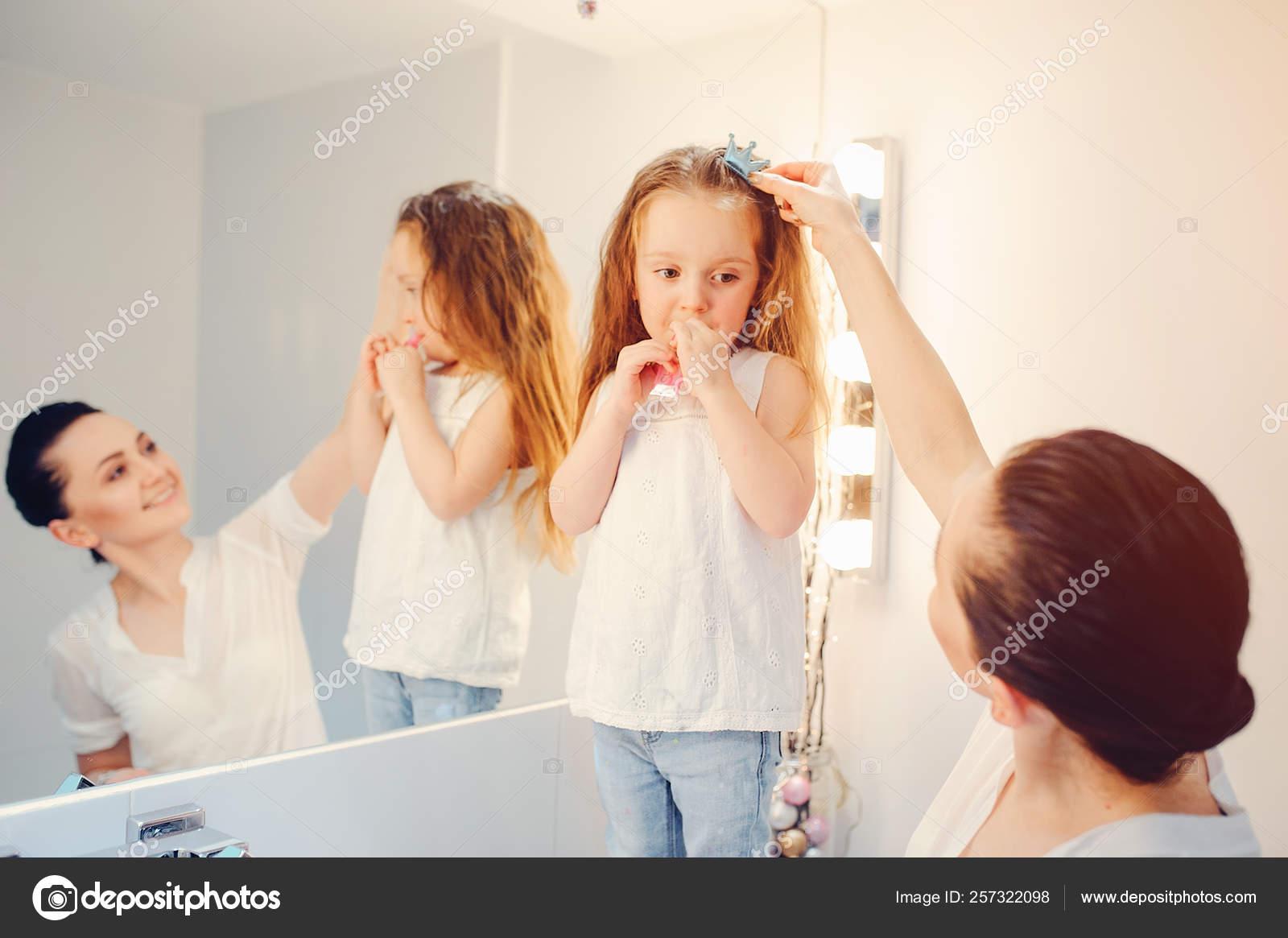Cute Family Have Fun In A Bathroom Stock Photo