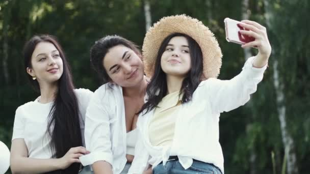 Photo of happy European women taking selfie photo and laughing