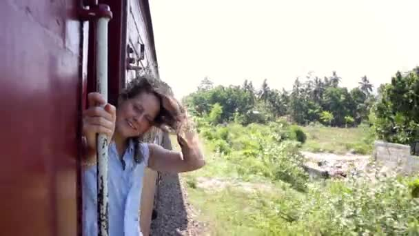 Portrait of a beautiful cheerful woman enjoying the train trip.
