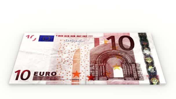 Videa. 3D obrázek. Zvýšit hromady bankovek deset euro na bílém pozadí