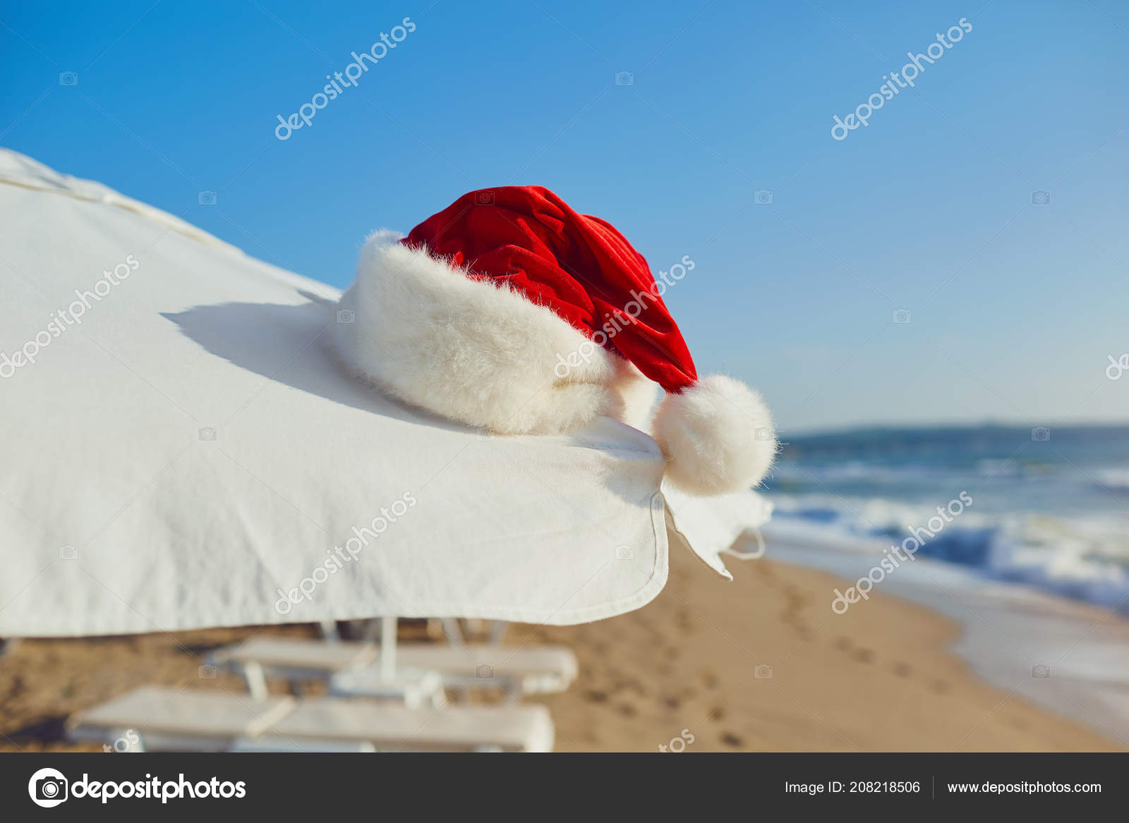santa claus hat on the beach by the sea christmas on vacation b stock