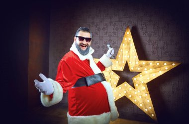 Santa Claus DJ on the background of the electric star in Christm