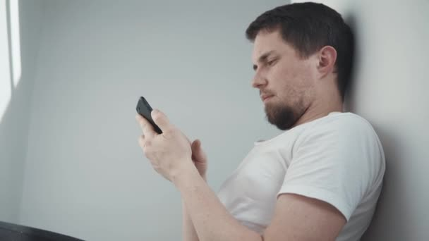 Man relaxing with smartphone.