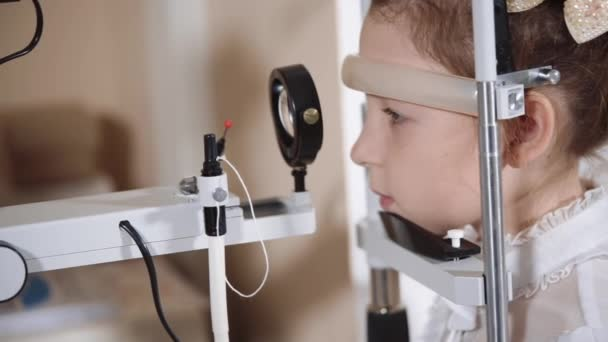 portrait of a teenager who checks eyesight in a childrens clinic at a doctor