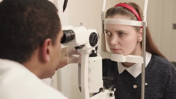 portrait of a student who checks eyesight on an ophthalmological apparatus