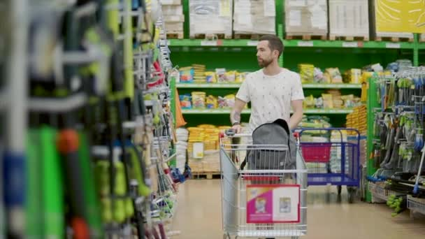 Guy with a shopping cart indoor.