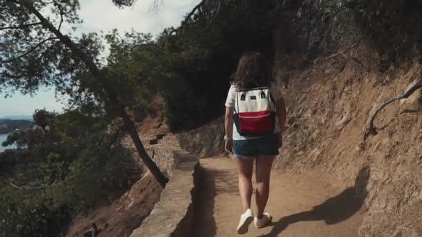 Female tourist walking in mountains.