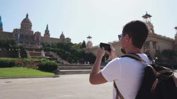 Tourist taking pictures on smartphone sightseeing.