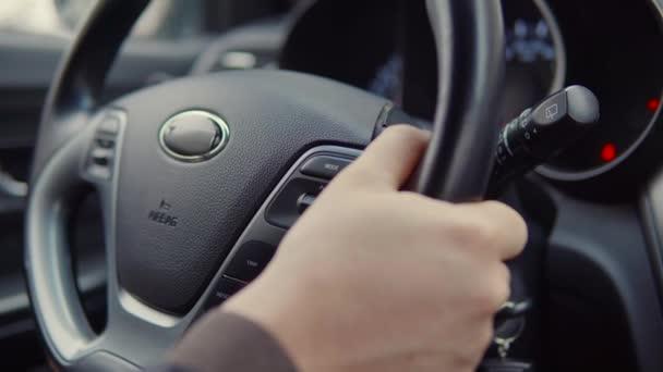 Hands on a car wheel.