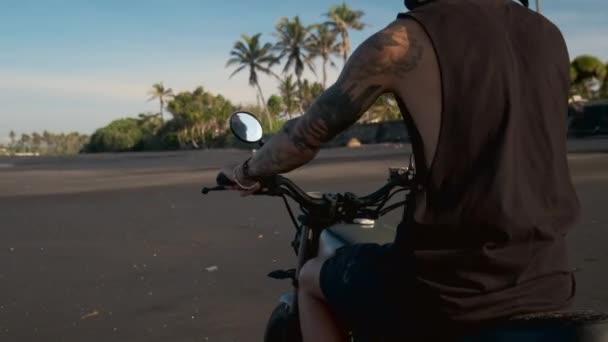 Motorbike ride on thee beach