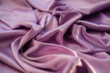 Close up pink fabric. The purple fabric is laid out waves. Fuchsia sateen fabric for background or texture. stock vector