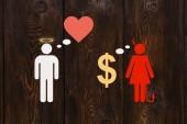 Fényképek Papír pár, love vs pénz fogalmát. Angyal ember és ördög nő. Elvont fogalmi kép