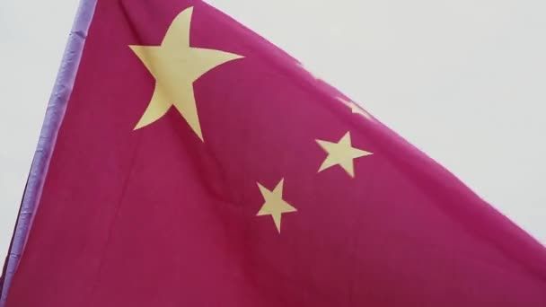Waving Chinese Flag  Flag of the Peoples Republic of China against the blue  sky