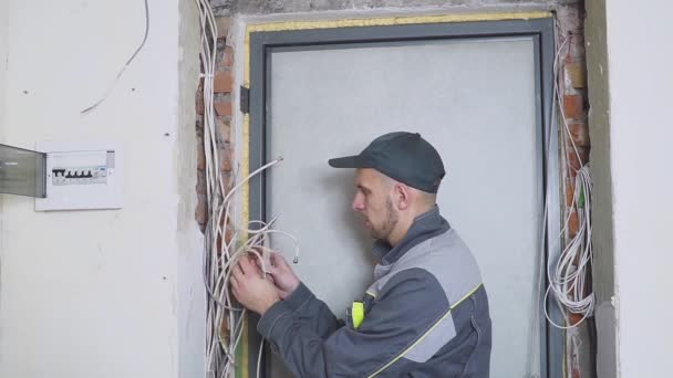 One electrician at work laying wiring cable. on wiring contractors, clutch works, electronics works, floor works, painting works, fabrication works, pump works, motor works,