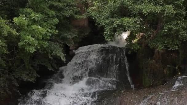 Waterfall mountain view close up. Mountain river waterfall landscape.
