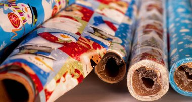 Rolls of assorted Christmas wrapping paper.