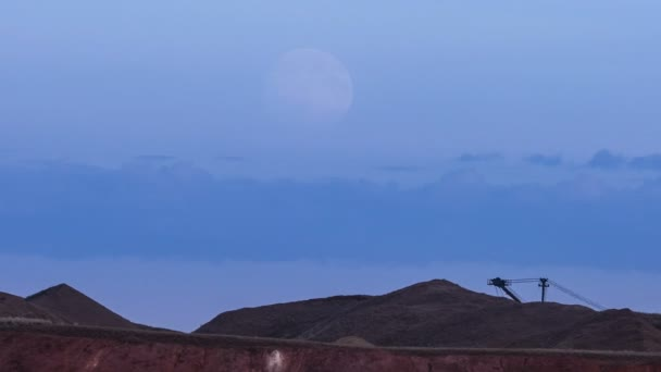 Super moon on the background of mining production.