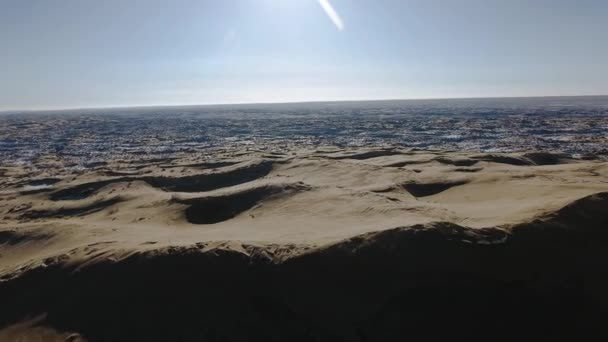Amazing aerial view of snow-covering sandy mountains in Western Kazakhstan, Mangyshlak Peninsula. Desert in the snow.