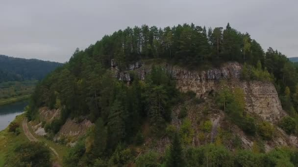 Flying over the amazing autumn mountain cliff . River. Ural, Russia.