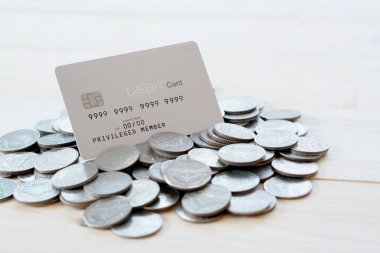 A Dedit cards with  coins