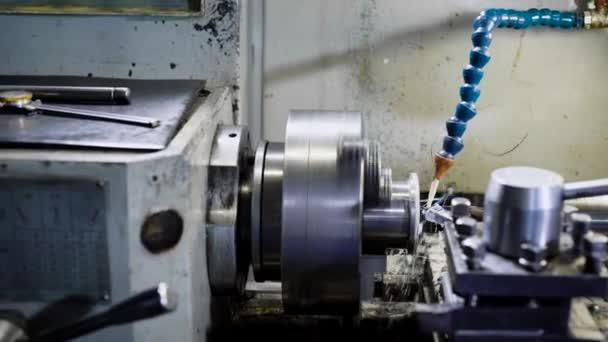 CNC lathe machine Turning machine cutting the metal screw thread part .Hi-precision CNC machining concept.
