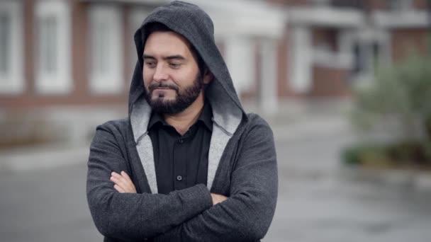 Portrait of handsome unshaven guy in grey hoodie, urban man in dressed stylish.