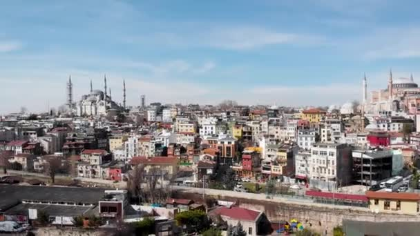 sealing an aerial view of spring Istanbul. Roofs of low houses and majestic mosques
