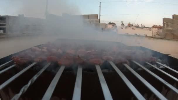 Shish kebab on skewers. Food grilling on barbecue. Preparing tasty meat barbeque on skewers.