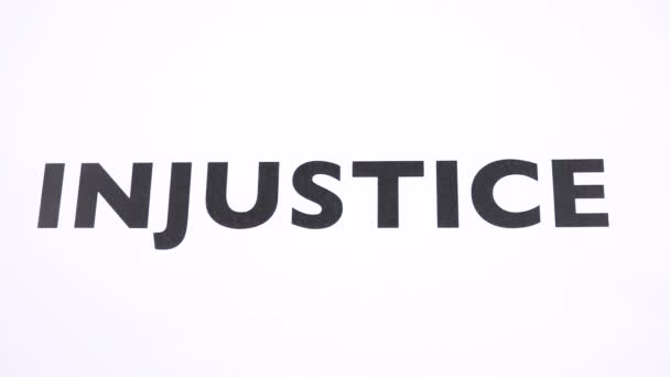 INJUSTICE prohibition symbol, refuse unfairness, inequality writing copy space. No malpractice, reject bias and abuse, inequity negative sign with white background. Concept of justice and integrity