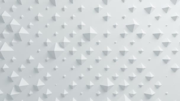 Beautiful White Pyramids on Surface Morphing in Seamless 3d Animation. Abstract Motion Design Background. Computer Generated Process. 4k UHD 3840x2160.