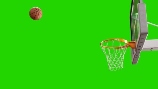 Spinning kosárba repülő labdát nettó lassítva a zöld képernyő. Gyönyörű szakmai dobja a kosárlabda karika. Sport koncepció. 3D animáció 4k Uhd 3840 x 2160.