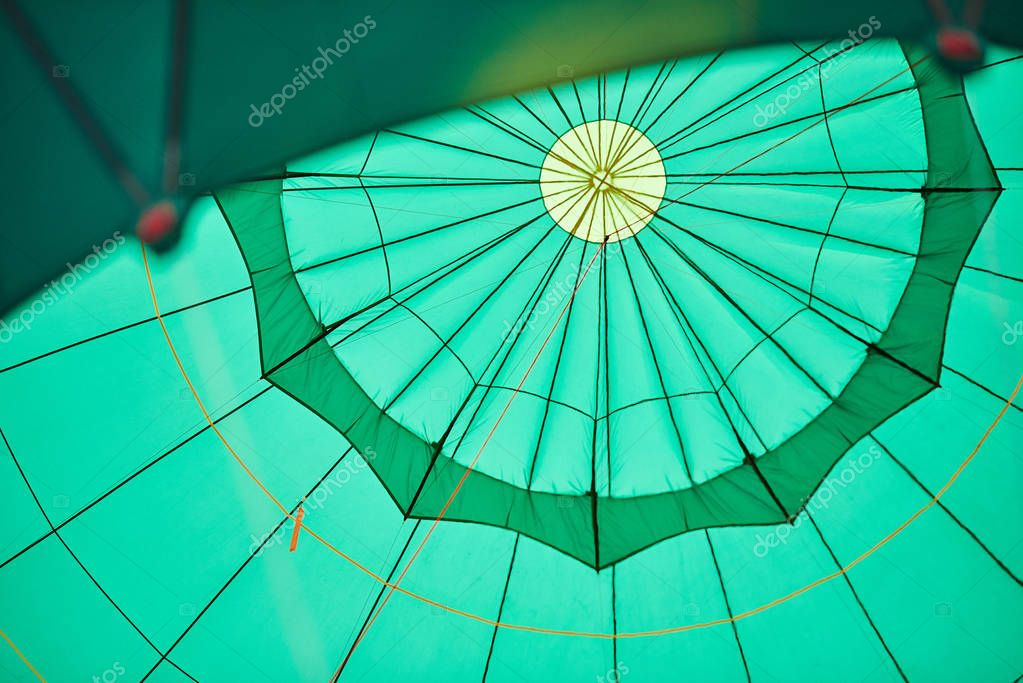 Green balloon from the inside, with ropes
