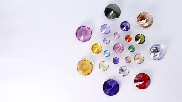 beautiful diamonds are turn around on the rotating diamond showcase.