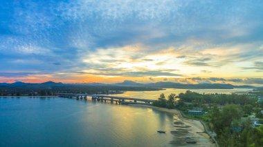 scenery sunrise above Sarasin bridge. fishing boats parking on the Sarasin beach. Sarasin bridge linking the province of Phang Nga and Phuket.