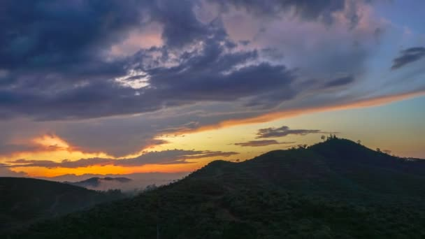 time lapse light through the cloud above mountain at sunset